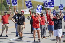 Striking workers outside a General Motors plant