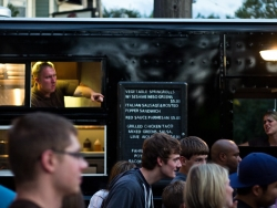 Man in food truck looking at customers