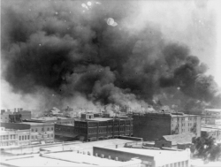 Smoke billows over Tulsa, Okla. after the Tulsa Race Massacre