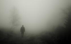 figure walking in fog