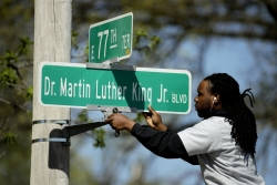 person changes a street sign to Dr. Martin Luther King, Jr. BLVD