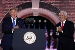 President Donald Trump and Vice President Mike Pence stand on stage at the RNC