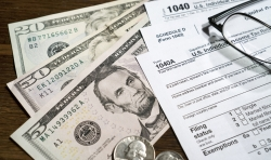 Cash and a 1040A tax form