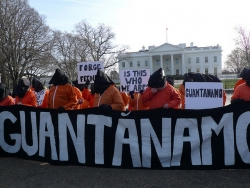 Demonstrators protesting the Guantanamo Bay Detention Facility outside of the White House in Washington DC