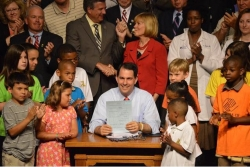 Gov. Scott Walker signs the 2013-15 budget