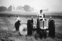 Women on a tractor and horse