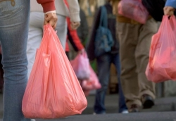 Shoppers carry plastic bags