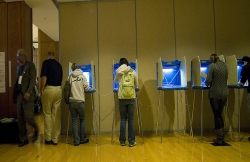 line of voters casting ballots