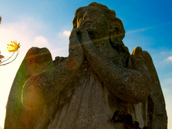 Gothic angel statue with sun flare