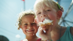 Girls eating cream puffs at the Wisconsin State Fair