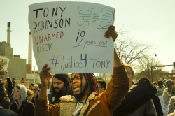 A man demonstrates on March 7, 2015 following the shooting death of Tony Robinson by Madison police.
