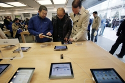 People looking at iPads