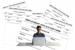 man filling our employment forms