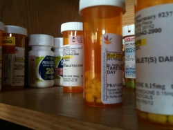 Prescription bottles on a shelf