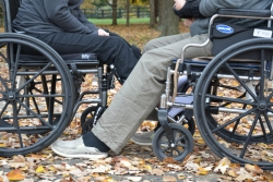Two people in wheelchairs