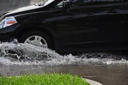 van driving through flood waters