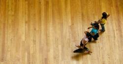 People walking on floorboards