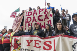 Protest Sign that reads DAPA, DACA