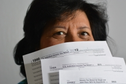 woman with tax forms