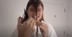 A woman in quarantine cutting her own bangs