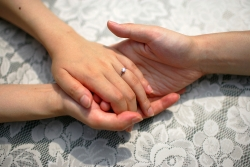 Engaged couple holding hands