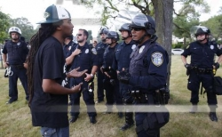 A man speaks with police in a park in Milwaukee