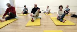 senior citizens practicing yoga