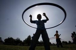 Children outside hula-hooping