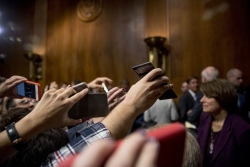 Reporters crowd Senators at the Senate Judiciary Committee hearing