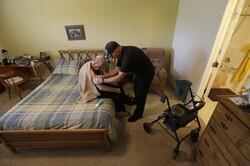 Caregiver helping a man with Alzheimer's