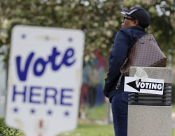 Woman stands outside polling place