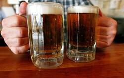 bartender serving two beers