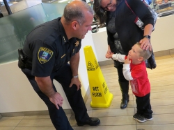 Officer talking with a child