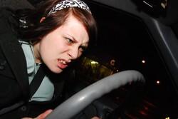 Angry girl at steering wheel