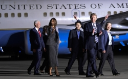 President Donald Trump walks with Tony Kim, third right, Kim Dong Chul, right, and Kim Hak Song, behind Trump, the three Americans detained in North Korea for more than a year