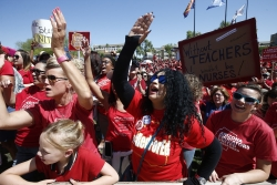 Teachers chant during continued protests at the Arizona Capitol