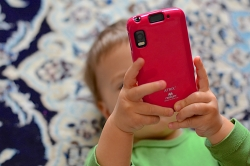 Kid holding a smartphone