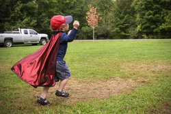 Child with a cape