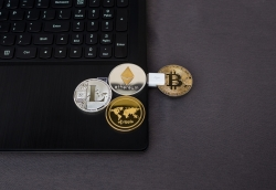 cryptocurrency coins on laptop