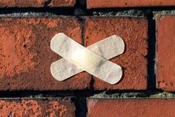 brick with bandage