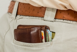 wallet in man's pocket