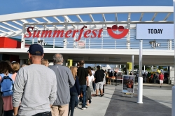 People wait in line to get into Summerfest