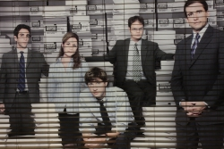 mural featuring 'The Office' cast members in stock room