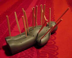toothpicks stuck in voodoo doll