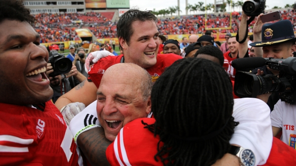Barry Alvarez hugs a player after a win at the Outback Bowl