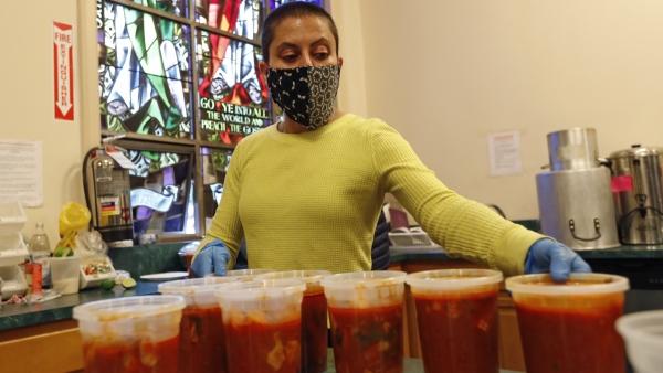 Brooklyn Immigrant Community Support volunteer coordinator Amy Khoshbin lines up quarts of chilate de pollo
