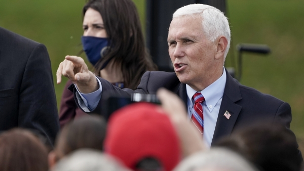 Vice President Mike Pence acknowledges the crowd at a Waukesha rally on Tuesday, Oct. 13.