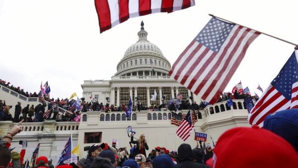 Supporters of President Donald Trump gather outside the U.S. Capitol