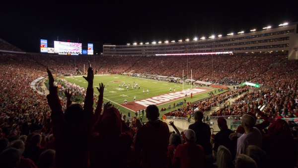 Wisconsin fans celebrate during night game at Camp Randall Stadium