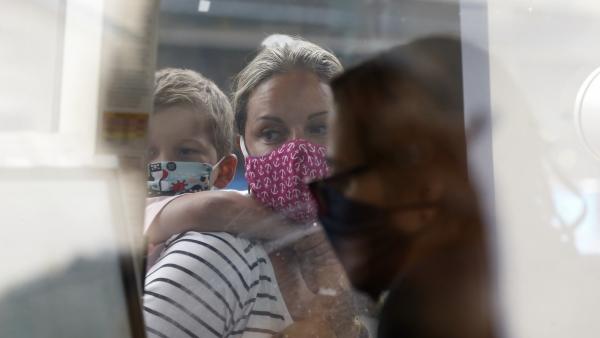 A woman wears a face mask at a Boston aquarium